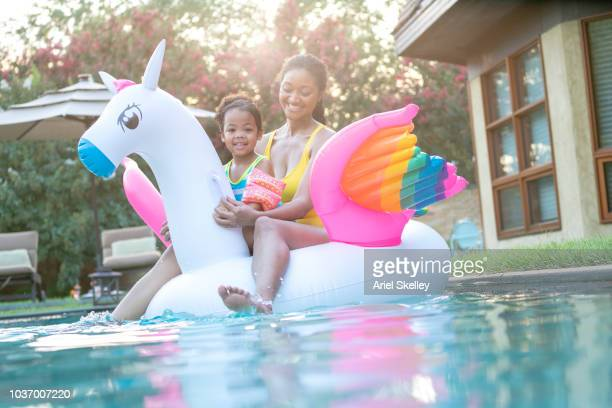 Mother and Daughter on Inflatable Pool Float
