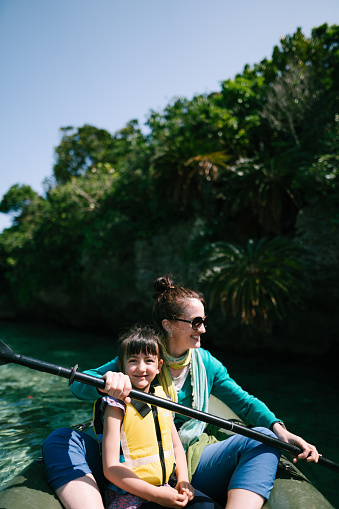 Mother and daughter on kayak on clear tropical water, Ishigaki Island, Japan - gettyimageskorea