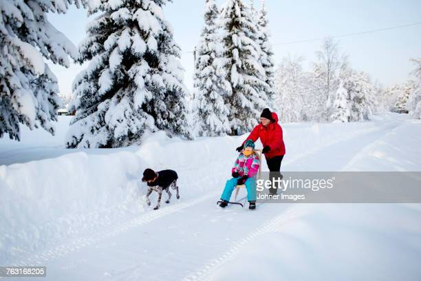 mother and daughter on kicksled - swedish lapland stock photos and pictures