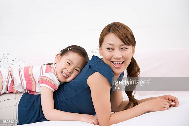 Mother and daughter on sofa