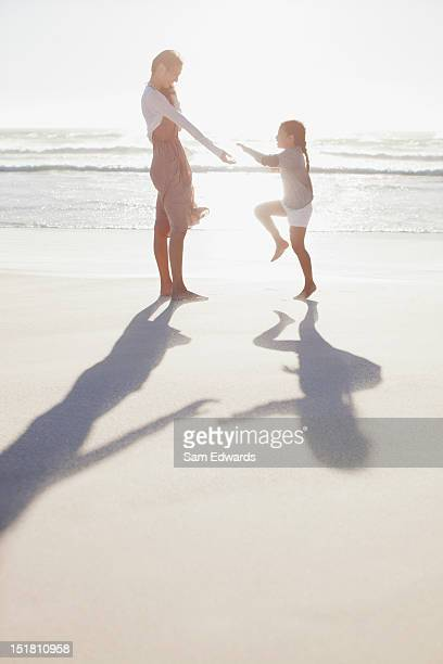 Mother and daughter on sunny beach
