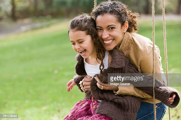 mother and daughter on swing - single mother stock pictures, royalty-free photos & images