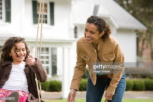 Mother and daughter on swing