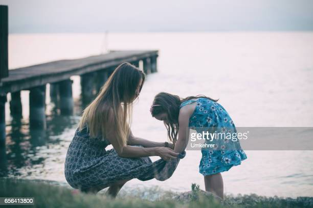 Mother and daughter on the sea