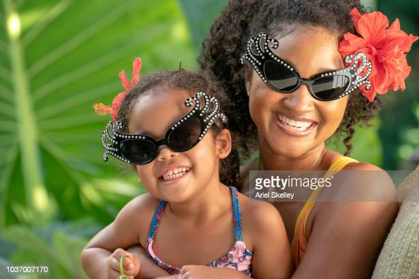 Mother and Daughter on Tropical Vacation with Silly Glasses