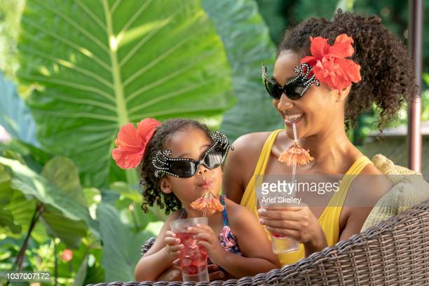Mother and Daughter on Vacation Drinking Fruit Punch
