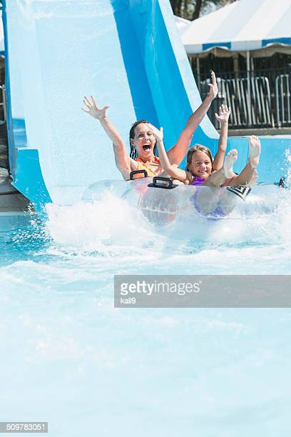 Mother and daughter on water slide