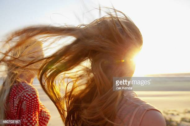 mother and daughter on windy beach, close up - india summer stock-fotos und bilder