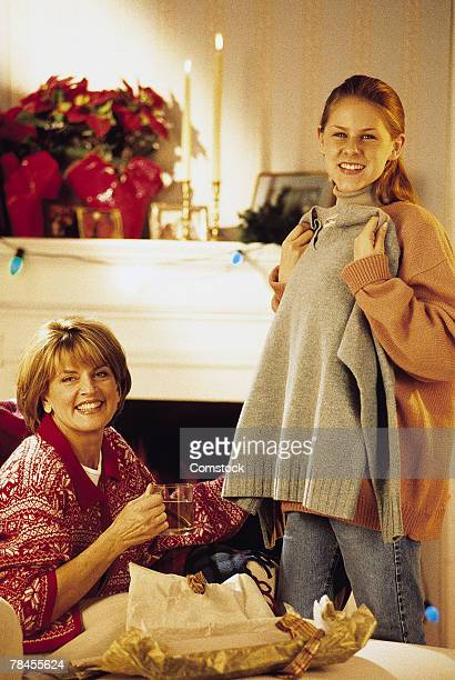 Mother and daughter opening gifts on Christmas