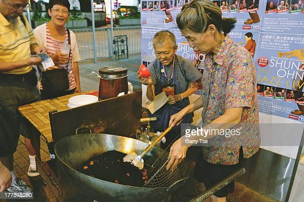 CONTENT] A mother and daughter opens a food cart stand selling roasted chestnuts