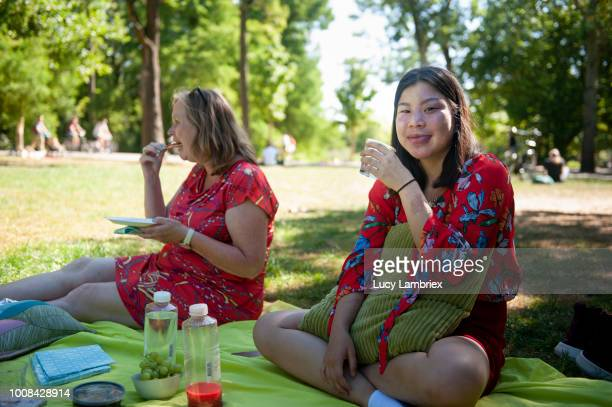 Mother and daughter out on a picnic in the park
