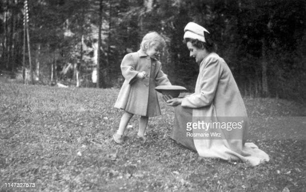 mother and daughter picking flowers - 1947 stock pictures, royalty-free photos & images