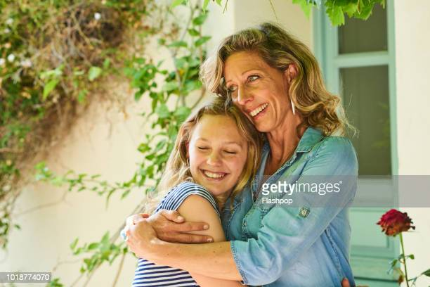 mother and daughter - tochter stock-fotos und bilder