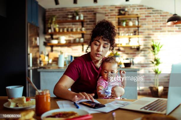 mother and daughter - financial bill stock pictures, royalty-free photos & images