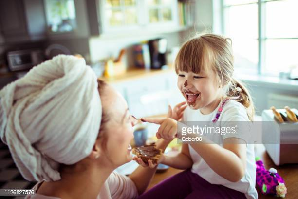 mother and daughter - spread food stock pictures, royalty-free photos & images