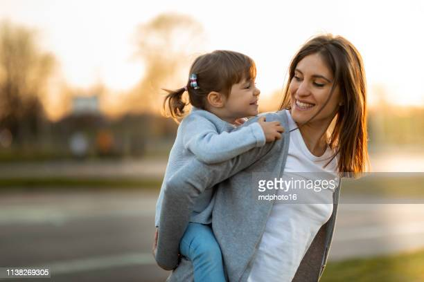 mother and daughter - piggyback stock pictures, royalty-free photos & images