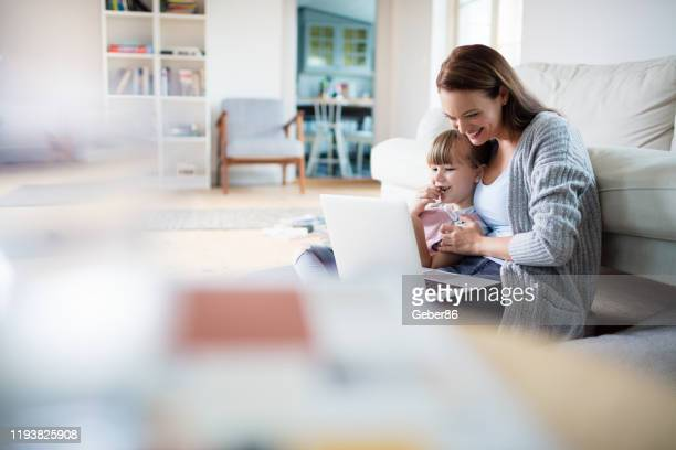 mother and daughter - home interior stock pictures, royalty-free photos & images