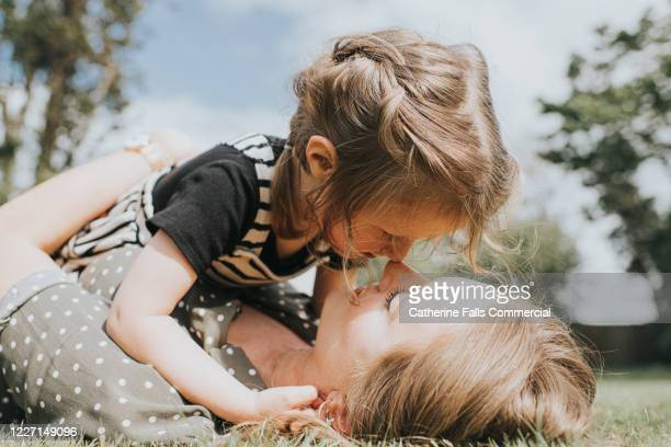 mother and daughter - daughter stock pictures, royalty-free photos & images