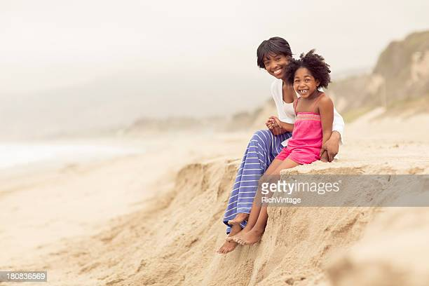 mother and daughter - mothers day beach stock pictures, royalty-free photos & images