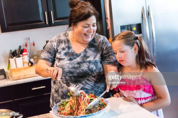 mother and daughter - fat girls stock photos and pictures