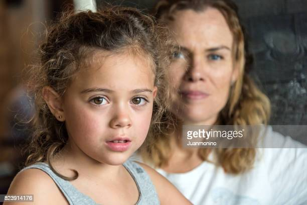 mother and daughter - serious stock pictures, royalty-free photos & images
