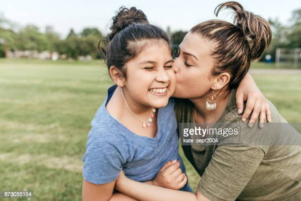 mother and daughter - iberian ethnicity stock pictures, royalty-free photos & images