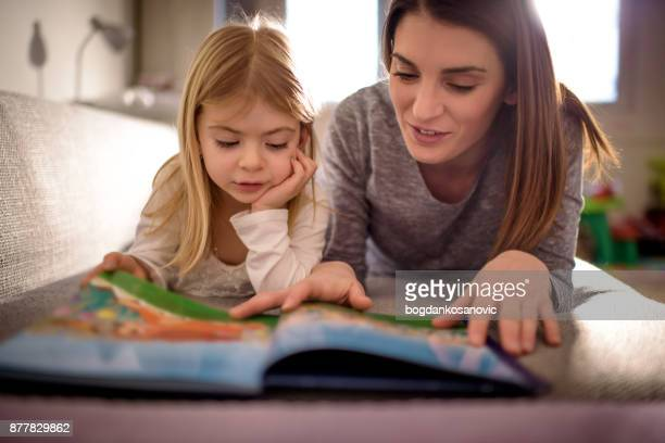 mother and daughter - reading stock pictures, royalty-free photos & images