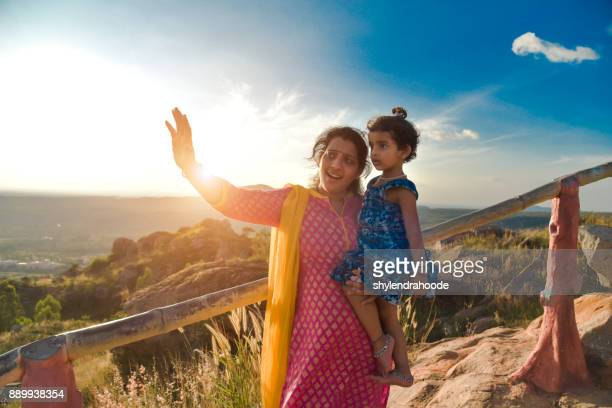mother and daughter - hinduism stock pictures, royalty-free photos & images