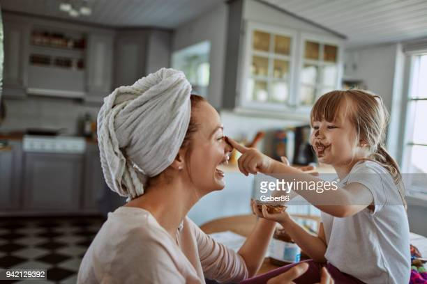 mother and daughter - mask disguise stock pictures, royalty-free photos & images