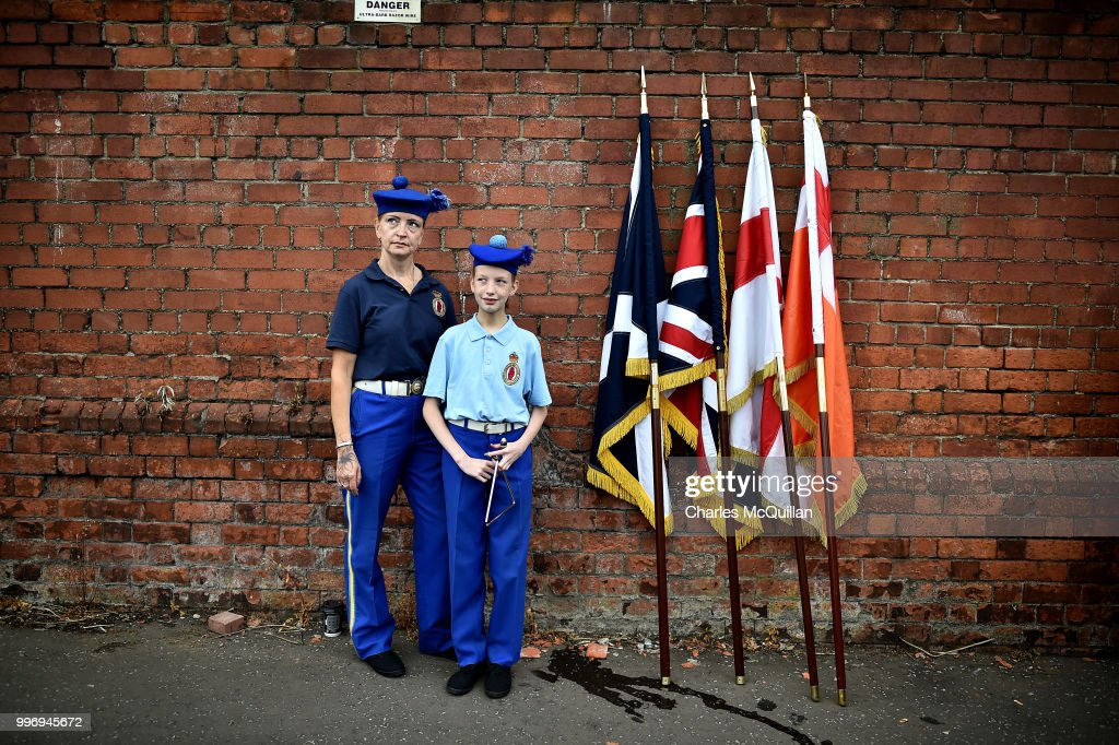 A mother and daughter pictured before the start of the annual 12th of July Orange march and demonstration takes place on July 12, 2018 in Belfast, Northern Ireland. The marches across the province celebrate King William of Orange's victory over the Catholic King James at the Battle of the Boyne in 1690.