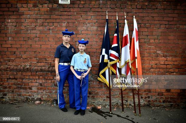 A mother and daughter pictured before the start of the annual 12th of July Orange march and demonstration takes place on July 12 2018 in Belfast...