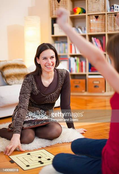 Mother and daughter playing board game