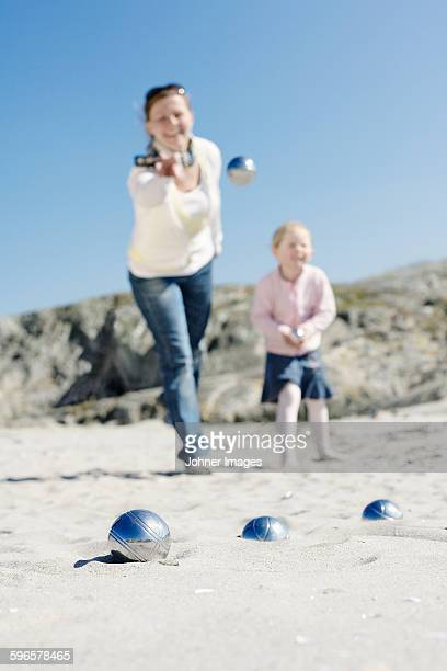 Mother and daughter playing boules