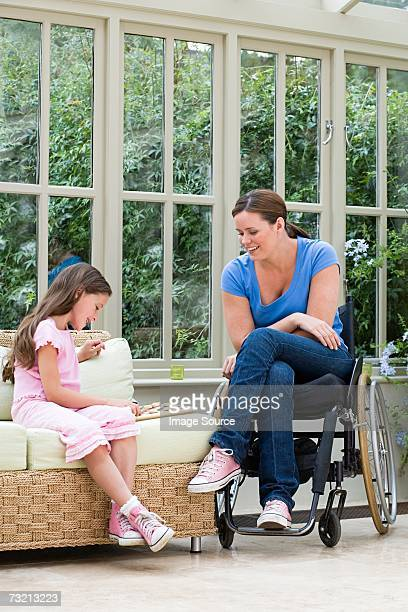 mother and daughter playing draughts - a sense of home stock photos and pictures