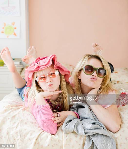 mother and daughter playing dress up - indian girl kissing stock photos and pictures