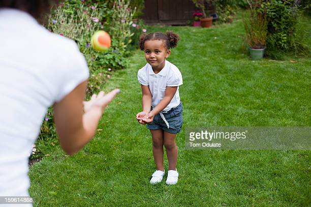 mother and daughter playing in garden - catching stock pictures, royalty-free photos & images