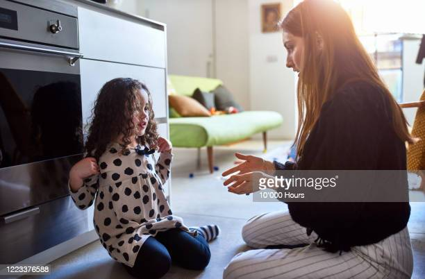 mother and daughter playing in kitchen - showing respect stock pictures, royalty-free photos & images