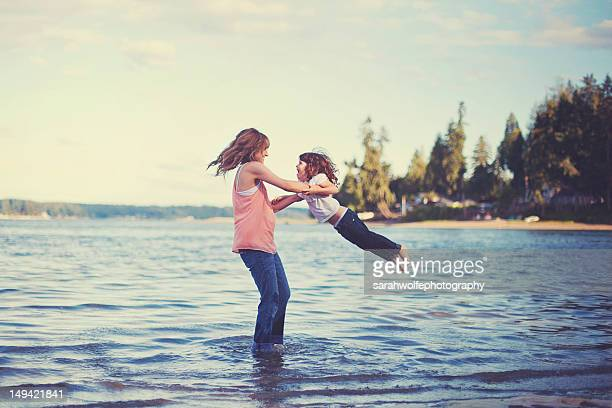 Mother and daughter playing in sea