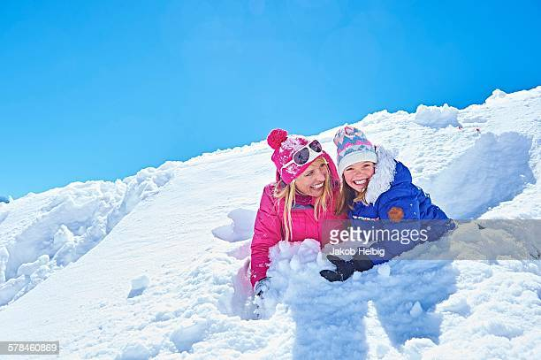 Mother and daughter playing in snow, Chamonix, France