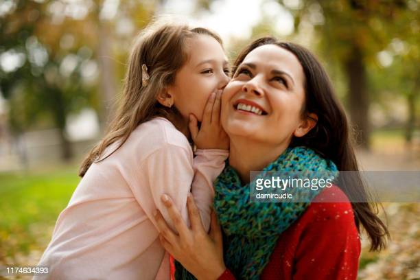 mother and daughter playing in the park - damircudic stock photos and pictures