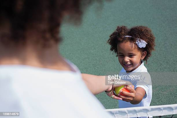Mother and daughter playing on court