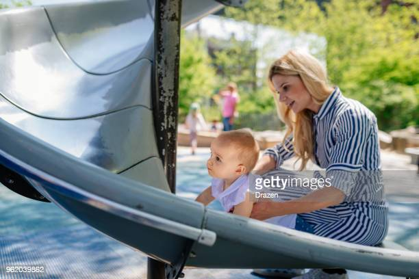 Mother and daughter playing on the slide