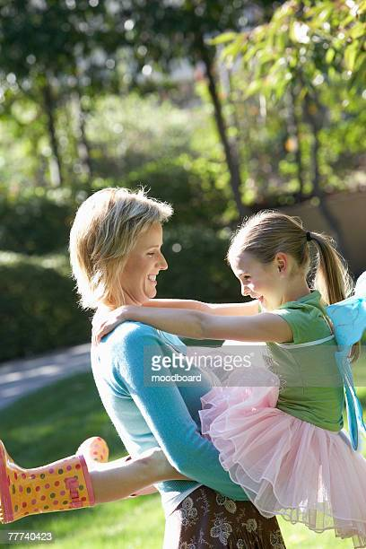 mother and daughter playing outside - little girls dressed up wearing pantyhose stock photos and pictures