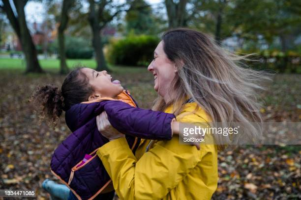 mother and daughter playing - primary age child stock pictures, royalty-free photos & images