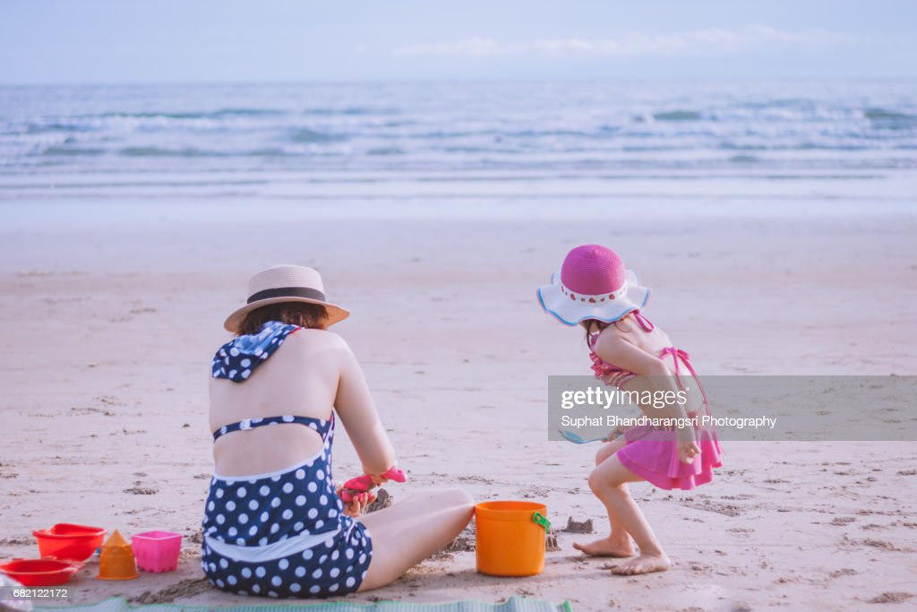 Mother and daughter playing sand toys : Stock Photo