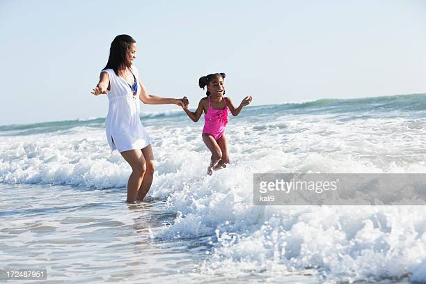 Mother and daughter playing surf