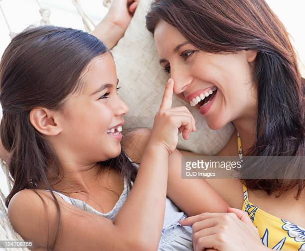 Mother and daughter playing together cheerfully