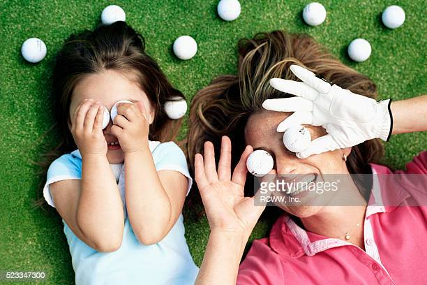 Mother and Daughter Playing with Golf Balls