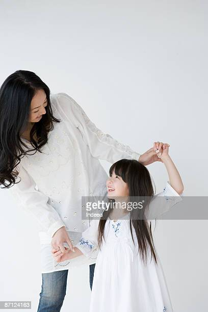 mother and daughter playing with hands - 見つめる ストックフォトと画像