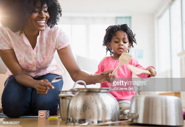 mother and daughter playing with pots and pans - drum percussion instrument stock pictures, royalty-free photos & images